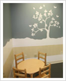 Photo of wall mural and small table in the Special Victim's Center