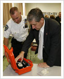 Photo of DA Zugibe examining an ignition interlock device
