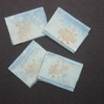 Photo showing 4 envelopes or bags containing heroin