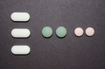 Photo showing oxycodone pills of various sizes